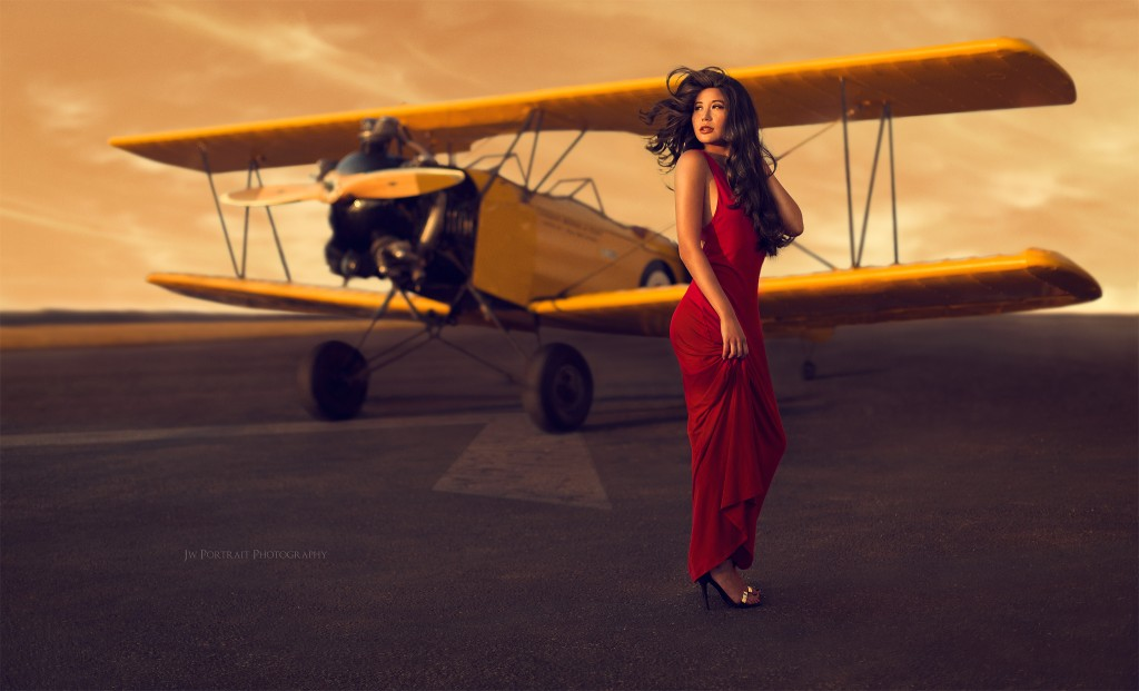 Sunset red dress photoshoot at the Canadian Museum of Flight, Image taken by photographer Eric J.W. Li and hair and make up by Teresa Binkle who studied at the Blanche Macdonald Centre in Vancouver